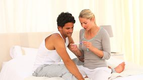 Young couple with a positive pregnancy test. In their bedroom stock footage