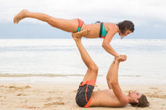 Young couple  practice an exercise in trust on a tropical beach Royalty Free Stock Images
