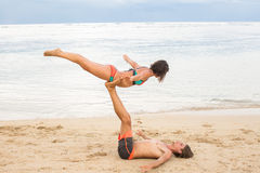 Young couple  practice an exercise in trust on a tropical beach Stock Photo