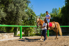 Young couple practices horseback riding lessons Stock Photo