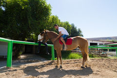 Young couple practices horseback riding lessons Royalty Free Stock Photo