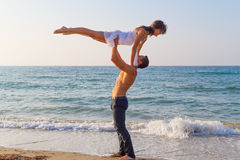 Young couple practicing a dance scene at the beach. Royalty Free Stock Photos