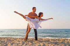 Young couple practicing a dance scene at the beach. Stock Photo