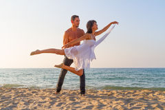 Young couple practicing a dance scene at the beach. Stock Images