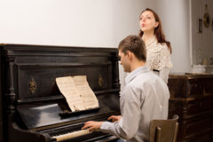 Young couple practicing a musical duet Royalty Free Stock Photo