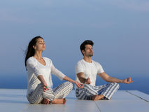 Young couple practicing yoga Royalty Free Stock Photography
