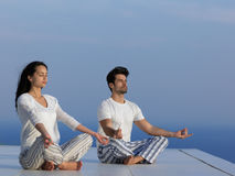 Young couple practicing yoga Stock Photo