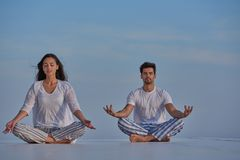 Young couple practicing yoga Royalty Free Stock Images