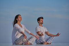 Young couple practicing yoga Stock Photography