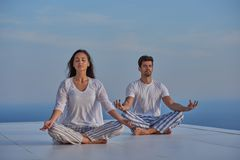 Young couple practicing yoga Stock Photos