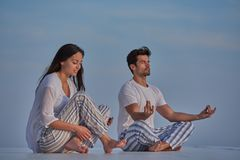 Young couple practicing yoga Royalty Free Stock Photos