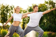 Young couple practising yoga Royalty Free Stock Photo