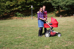Young couple and pram Stock Photos