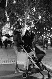 Young couple with pram stroller admiring the Christmas illuminat. STRASBOURG, FRANCE - NOV 29, 2017: Black and white image of young couple with pram stroller Stock Photos