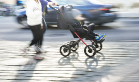 Young couple with pram Royalty Free Stock Photo