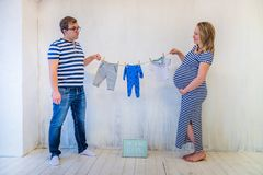 Young couple: pregnant woman and man royalty free stock photography