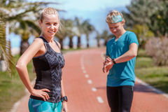 Young couple prepare to start jogging Royalty Free Stock Image