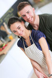 Young couple prepared cake standing in the kitchen Royalty Free Stock Photography