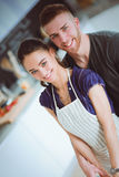 Young couple prepared cake standing in the kitchen Royalty Free Stock Image