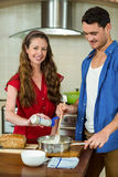 young couple preparing batter in pan Royalty Free Stock Image