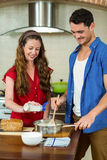 young couple preparing batter in pan Stock Images
