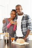 Young Couple Preparing Breakfast In Kitchen Royalty Free Stock Photography