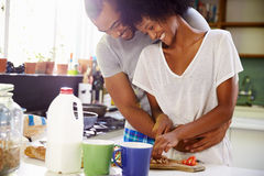 Young Couple Preparing Breakfast In Kitchen Together Stock Photos
