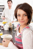 Young Couple Preparing Breakfast In Modern Kitchen Royalty Free Stock Image
