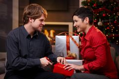 Young couple preparing for christmas eve Stock Images