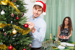 Young couple preparing for Christmas Stock Photos