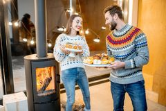Couple with festive meals during the winter holidays indoors stock photography