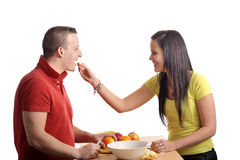Young couple preparing a fruit salad Stock Photography