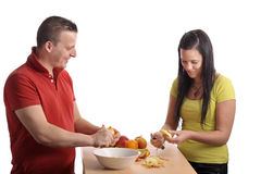Young couple preparing a fruit salad Royalty Free Stock Image