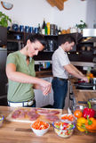 Young couple preparing lunch Stock Photo