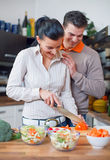 Young couple preparing lunch Royalty Free Stock Images