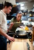 Young couple preparing lunch Stock Photos