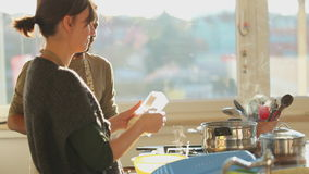 Young couple preparing lunch in the kitchen stock video footage