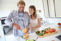Young couple preparing lunch together Royalty Free Stock Photography