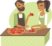 Young couple preparing pizza together Royalty Free Stock Photography