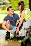 Young couple preparing for rollerblades Royalty Free Stock Image