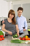 Young couple preparing salad royalty free stock photo