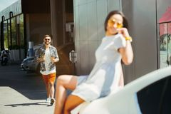 Young couple preparing for vacation trip on the car in sunny day. Woman and men shopping and ready for going to sea, riverside or ocean. Concept of stock photos