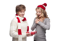 Young couple presenting christmas gift Stock Photography