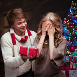 Young couple presenting christmas gift Stock Photos