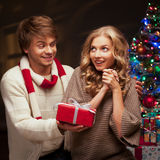 Young couple presenting christmas gift stock images