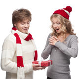 Young couple presenting christmas gift Stock Photo