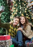 Young Couple With Presents Sitting In Christmas Royalty Free Stock Photo
