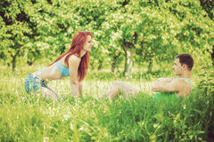 Young couple press up on nature instagram stile Royalty Free Stock Photo