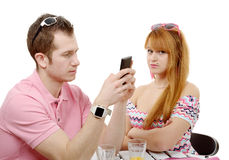 Young couple with problems, man phone Royalty Free Stock Image
