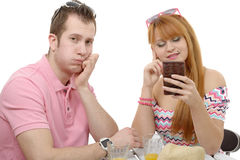 Young couple with problems, woman phone Royalty Free Stock Photos